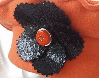 Kids fleece beret orange and black flower enhanced with a cute button orange