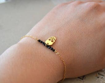 Skull and onyx gold plated bracelet