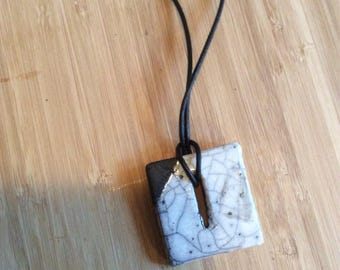 Raku pendant on leather cord