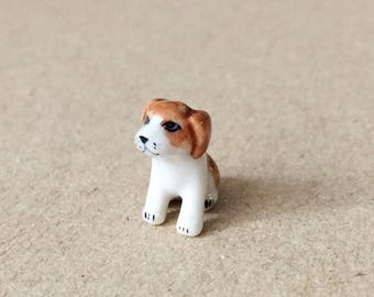 Brown and white puppy tiny ceramic  -  size 1.4cm.x1.6cm.  - Made of ceramic and painting