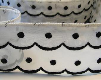 White Ribbon transparent polka dot black, 60 mm, sold by the yard.