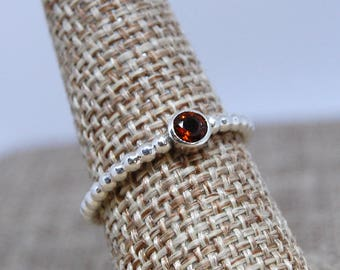 Round 4mm faceted Garnet Ring size 8 Sterling Silver