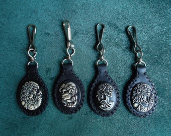 Embellished with a carved concho leather keychain