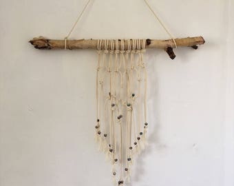 Macrame natural rope wall hanging on silver birch branch