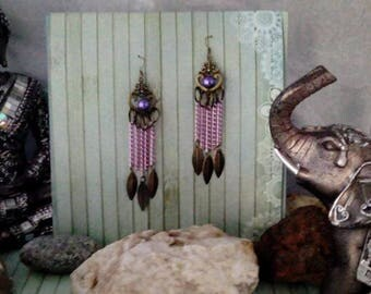 A pretty pair of earrings in bronze glass and aluminum