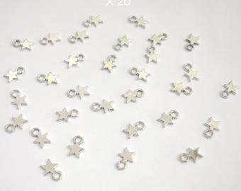 Silver X 20 piece color star charms