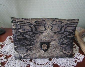 Fancy canvas pouch: black, gold, bronze.