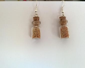 Earrings in the shape of bottles with beads