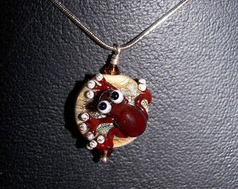 Glass - brown frog on ivory Pebble necklace