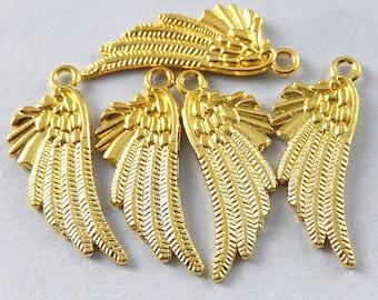 5 pendants wings shining gold, great creations of jewels, earrings...