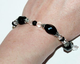 Black and silver color beaded bracelet