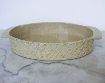 Textured white oval stoneware baking/serving dish with handles handcrafted with woodblock imprint