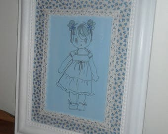 Frame white weathered wood with liberty fabric decorated with a blue and Doll