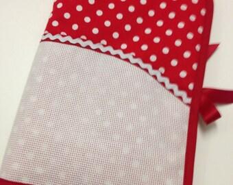Health book has cross-stitch, polka dots white red background. Minnie