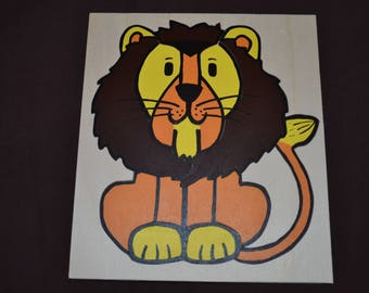 Pretty wooden puzzle of nine pieces of a lion