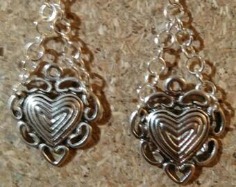 Silver heart shaped dangling earrings