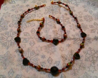 set (necklace and bracelet) fine, classy, modern (red and black)