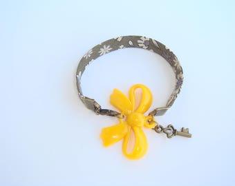 child bracelet bronze metal orange bow
