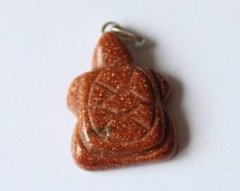Red sequin turtle stone pendant
