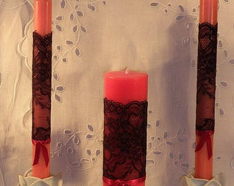 For Valentine's day, consider discounts! Trio of Red candles on Black Lace
