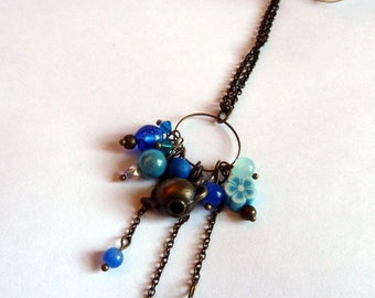 Blue cluster with teapot charm necklace