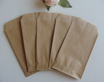 1 lot of 10 kraft brown paper bag jewelry gift packaging natural 7 * 12 cm Brown background