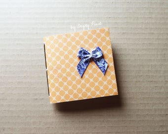 Small orange pattern book retro with a bow