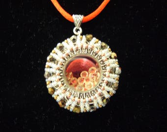 Unique hand woven pendant with movable rhinestones