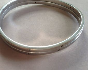 Silver bangle with diamond detail