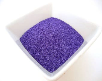 Bag of 10g of Pearlescent purple colored glass