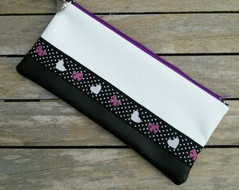 Clutch or wallet imitation leather black and white. Stripe fabric bows and hearts. Black lining with white polka dots.
