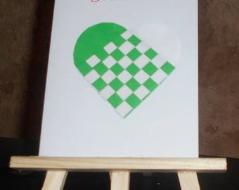 """Card """"I give you my heart"""" with a braided green and white heart"""
