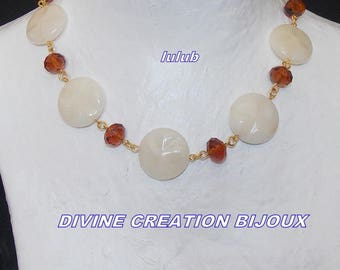 Set in unbleached natural stones and amber faceted glass beads