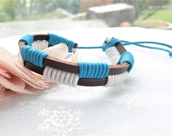 Brown leather and blue cord and white cord bracelet