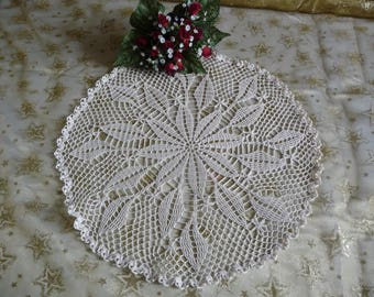 Handmade crochet ecru cotton lace doily.