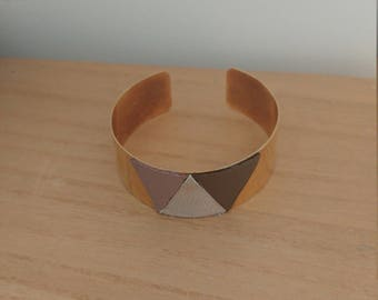 Cuff with leather triangles