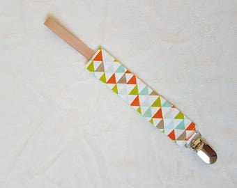 Hanging pacifier Brown or orange triangles pattern