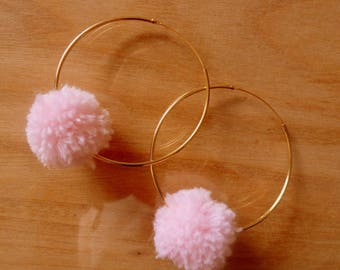 Metal Gold hoop earrings and pink tassels