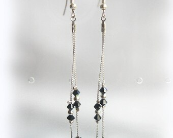 Very long and elegant black crystal earrings