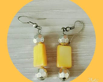 earring with yellow bead