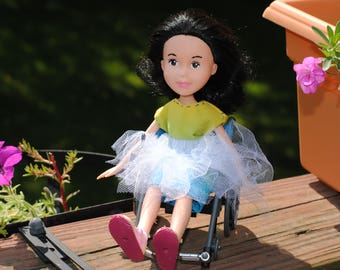 Repainted Bratz doll with wheelchair and fairy skirt