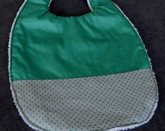 Green bib and polka dots
