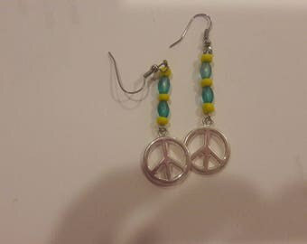 Peace sign charm with yellow and blue beaded earrings