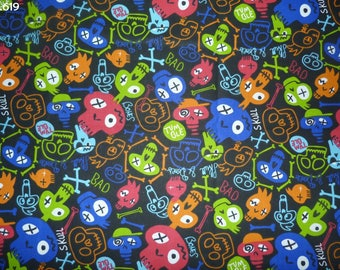 Fabric C619 skulls colored on black coupon 35x50cm
