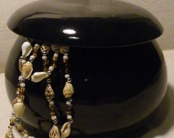 Black terracotta jewelry box.