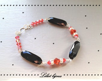 Coral colored coral and black Swarovski Crystal bracelet