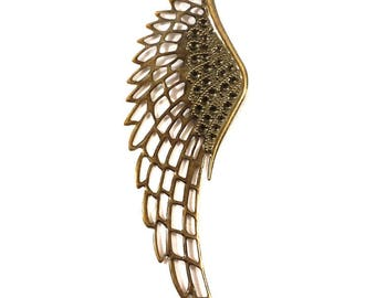 A finely crafted wing charm