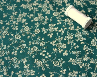 Beige patchwork flowers on green background fabric