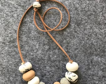 Polymer clay necklace. A neutral polymer clay necklace