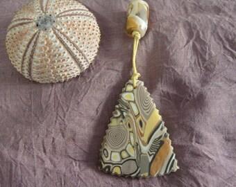 Safari colors sand, ochre, yellow, black number 1 pendant
